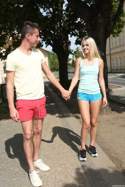 Young blonde girl drags her..